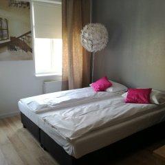 Апартаменты Novitas Apartments Вроцлав комната для гостей фото 2