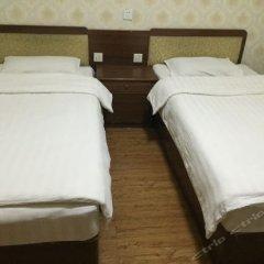 Отель Xinxinlong Inn комната для гостей