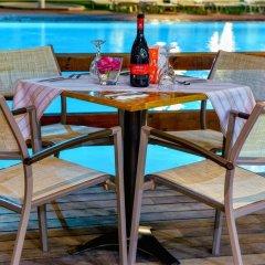 Отель smartline Cosmopolitan Hotel Греция, Родос - отзывы, цены и фото номеров - забронировать отель smartline Cosmopolitan Hotel онлайн питание фото 2
