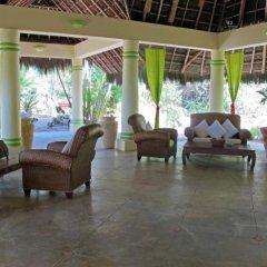 Tamarind Beach Hotel & Yacht Club интерьер отеля