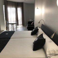Отель Aparthotel Quo Eraso Мадрид комната для гостей фото 2