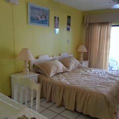 Отель Chrisanns Beach Resort Ямайка, Очо-Риос - отзывы, цены и фото номеров - забронировать отель Chrisanns Beach Resort онлайн комната для гостей