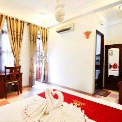 Отель Nhi Nhi Хойан удобства в номере фото 2