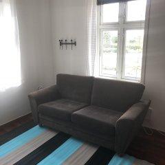 Отель Gauk Apartments Sentrum 4 Норвегия, Санднес - отзывы, цены и фото номеров - забронировать отель Gauk Apartments Sentrum 4 онлайн комната для гостей фото 2