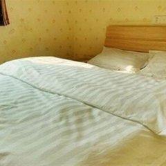 Отель Xiamen Yiqing Apartment Китай, Сямынь - отзывы, цены и фото номеров - забронировать отель Xiamen Yiqing Apartment онлайн комната для гостей фото 2