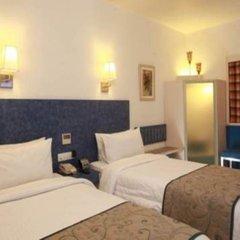 Отель Tulip Inn West Delhi комната для гостей фото 3