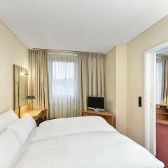 Отель NH München Unterhaching Германия, Унтерхахинг - 1 отзыв об отеле, цены и фото номеров - забронировать отель NH München Unterhaching онлайн комната для гостей фото 2