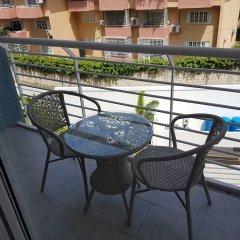 Отель Secure New Kingston Condo Ямайка, Кингстон - отзывы, цены и фото номеров - забронировать отель Secure New Kingston Condo онлайн балкон