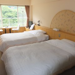 Отель Kinugawa Park Hotels Park Cottage Никко комната для гостей