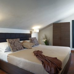 Апартаменты Navona Luxury Apartments комната для гостей фото 10