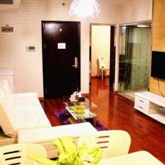 Апартаменты Shenzhen Haicheng Apartment комната для гостей фото 2