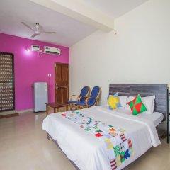 Апартаменты OYO 13211 Home Spacious Studio Morjim Beach Гоа комната для гостей