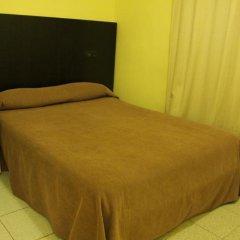 Отель Hostal Baires удобства в номере