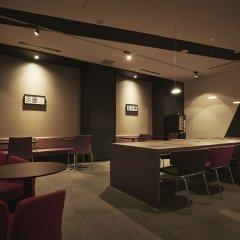 Отель First Cabin Akihabara Япония, Токио - отзывы, цены и фото номеров - забронировать отель First Cabin Akihabara онлайн гостиничный бар
