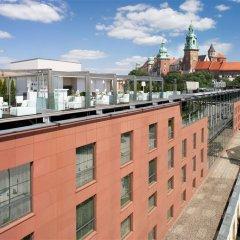 Отель Sheraton Grand Krakow Краков приотельная территория фото 2