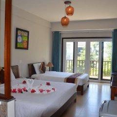 Sunshine Hotel Хойан комната для гостей фото 2