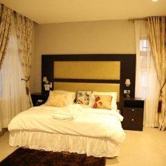 Отель Kiniz Luxury Apartments Нигерия, Уйо - отзывы, цены и фото номеров - забронировать отель Kiniz Luxury Apartments онлайн комната для гостей фото 4