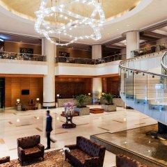 Отель Pullman Kuala Lumpur City Centre Hotel & Residences Малайзия, Куала-Лумпур - отзывы, цены и фото номеров - забронировать отель Pullman Kuala Lumpur City Centre Hotel & Residences онлайн интерьер отеля фото 3