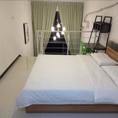 Апартаменты Kaimi Apartment Kesheng Plaza Branch комната для гостей фото 4