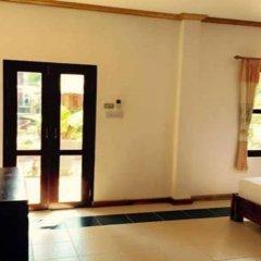 Отель Villa Oasis Luang Prabang сейф в номере