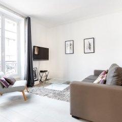 Апартаменты Eiffel Tower - Pont de l'Alma Apartment комната для гостей фото 5