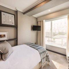 Отель 3 Bedroom Apartment With Garden in Knightsbridge Великобритания, Лондон - отзывы, цены и фото номеров - забронировать отель 3 Bedroom Apartment With Garden in Knightsbridge онлайн комната для гостей фото 3