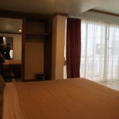 Апартаменты Rouge Service Apartments Паттайя комната для гостей фото 5