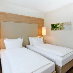 Отель H+ Hotel Salzburg Австрия, Зальцбург - 1 отзыв об отеле, цены и фото номеров - забронировать отель H+ Hotel Salzburg онлайн комната для гостей фото 3