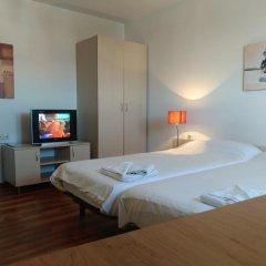 Апартаменты Gondola Apartments & Suites Банско комната для гостей