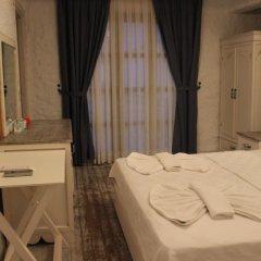 Отель Mina Otel Alacati Чешме сейф в номере