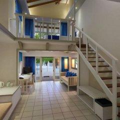 Отель Cinnamon Dhonveli Maldives-Water Suites Мальдивы, Остров Чаайя - отзывы, цены и фото номеров - забронировать отель Cinnamon Dhonveli Maldives-Water Suites онлайн интерьер отеля фото 3