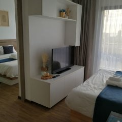 Отель Treetops Pattaya Condominium Паттайя комната для гостей