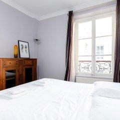 Апартаменты Eiffel Tower - Pont de l'Alma Apartment комната для гостей фото 2