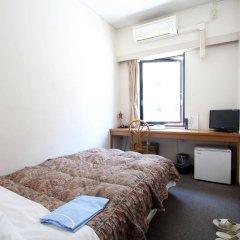 Отель Sakura Ikebukuro Токио комната для гостей