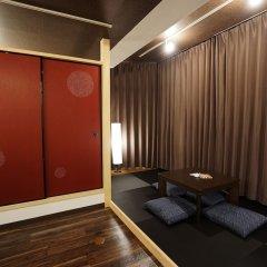 Отель Japanese Condominium UNO Ито комната для гостей фото 3