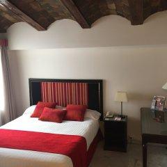 Ad Hoc Monumental Hotel сейф в номере