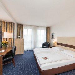 Отель Novum Hotel Mariella Airport Германия, Кёльн - 1 отзыв об отеле, цены и фото номеров - забронировать отель Novum Hotel Mariella Airport онлайн комната для гостей фото 2