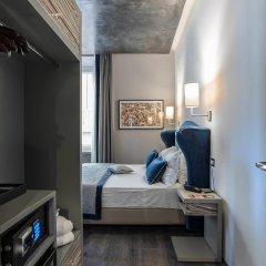 Отель Colonna Suite Del Corso сейф в номере