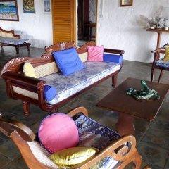Отель Sugar Reef Bequia Сент-Винсент и Гренадины, Остров Бекия - отзывы, цены и фото номеров - забронировать отель Sugar Reef Bequia онлайн интерьер отеля