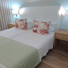 Отель Sea Garden Residência комната для гостей