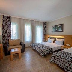 Отель Crystal Flora Beach Resort удобства в номере