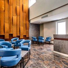 Отель The District Hotel Мальта, Сан Джулианс - 1 отзыв об отеле, цены и фото номеров - забронировать отель The District Hotel онлайн интерьер отеля фото 2