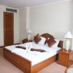 Отель Omni Tower Syncate Suites Бангкок комната для гостей фото 5