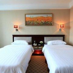 Отель Peony Wanpeng Hotel - Xiamen Китай, Сямынь - отзывы, цены и фото номеров - забронировать отель Peony Wanpeng Hotel - Xiamen онлайн комната для гостей фото 5