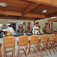 Отель Capital Coast Resort And Spa гостиничный бар фото 4