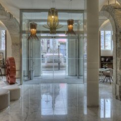 Отель NH Collection Porto Batalha интерьер отеля