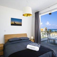 Отель Paradise Cove Luxurious Beach Villas Кипр, Пафос - отзывы, цены и фото номеров - забронировать отель Paradise Cove Luxurious Beach Villas онлайн комната для гостей фото 10