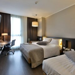 Отель Best Western Premier CHC Airport Италия, Генуя - 2 отзыва об отеле, цены и фото номеров - забронировать отель Best Western Premier CHC Airport онлайн комната для гостей фото 2