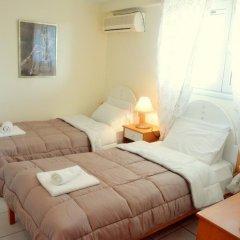 Отель Glyfada Gorgona Apartments Греция, Корфу - отзывы, цены и фото номеров - забронировать отель Glyfada Gorgona Apartments онлайн комната для гостей фото 2
