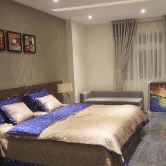 Апартаменты Sunny Serviced Apartment комната для гостей